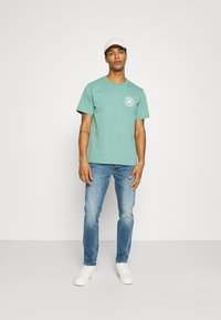 American Eagle - WASH - Jeans Slim Fit - faded light - 1