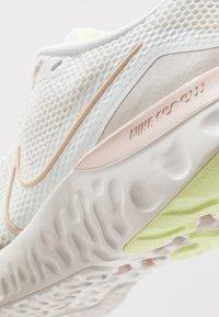 Nike Performance - RENEW RUN - Neutral running shoes - summit white/guava ice/light bone - 5