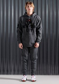 Superdry - MONO URBAN - Tracksuit bottoms - twisted black grit - 0