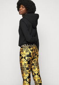 Versace Jeans Couture - LADY FUSEAUX - Leggings - Trousers - black - 3