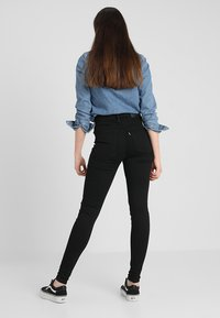 Levi's® - MILE HIGH SUPER SKINNY - Jeans Skinny Fit - black galaxy