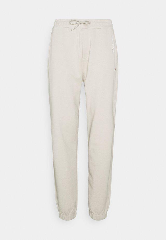 UNISEX - Spodnie treningowe - stone