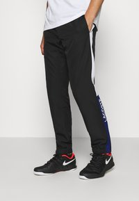 Lacoste Sport - TENNIS PANT - Tracksuit bottoms - black/cosmic white - 0
