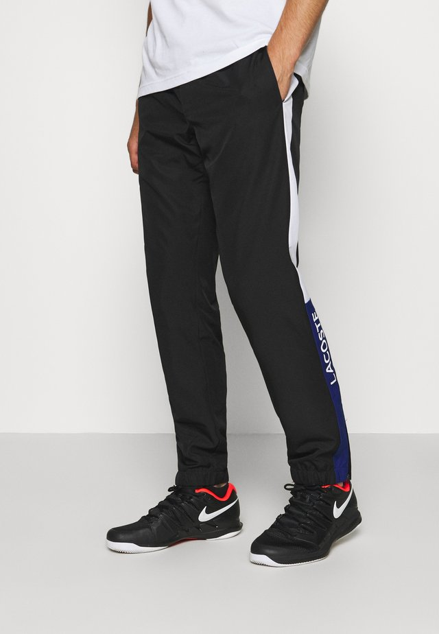 TENNIS PANT - Jogginghose - black/cosmic white