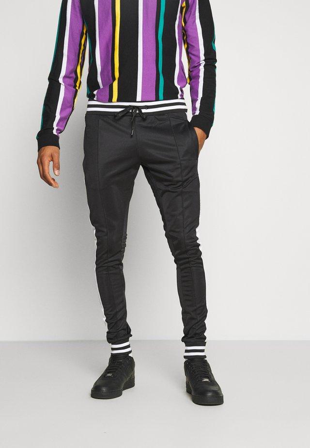 COLE - Pantaloni sportivi - black