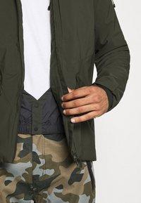 Peak Performance - MAROON LONG JACKET - Ski jacket - coniferous green - 6