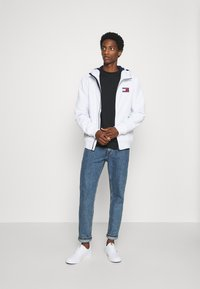 Tommy Jeans - PADDED JACKET - Light jacket - white - 1