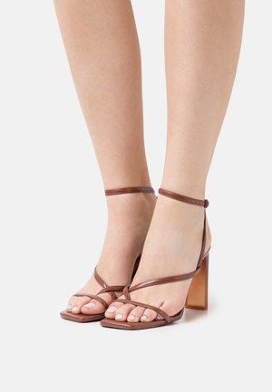 HAINIEL - T-bar sandals - medium red