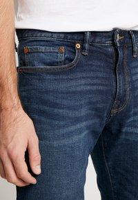 GAP - DARK CYPRESS - Straight leg jeans - tinted blue - 5