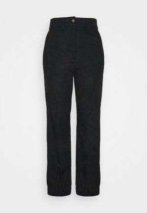 KARO - Trousers - black