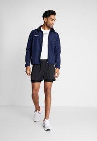 Craft - ADV ESSENCE STRETCH SHORTS - Sports shorts - black - 1