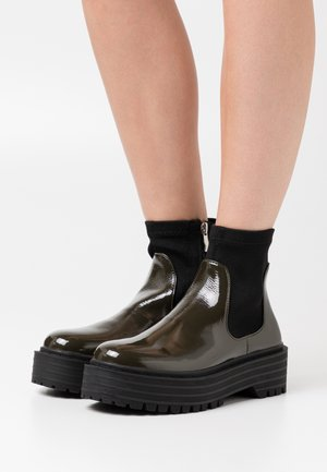 ROBYN - Platform ankle boots - green
