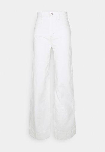 WIDE LEG - Flared jeans - ecru