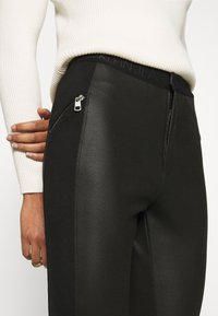Calvin Klein Jeans - MOTO COATED MILANO  - Leggings - Trousers - black - 6