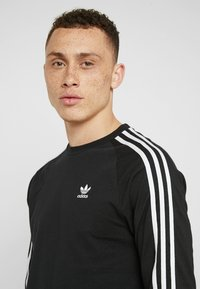 adidas Originals - 3 STRIPES CREW UNISEX - Sweatshirts - black - 5