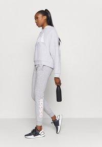 adidas Performance - HOODIE - Kapuzenpullover - light grey - 1