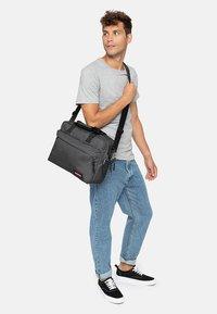 Eastpak - BARTECH CORE COLORS  - Across body bag - black denim - 1