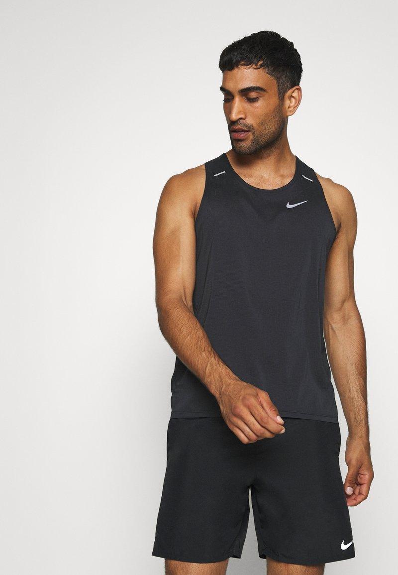 Nike Performance - RISE TANK - Sports shirt - black