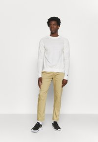 Nike Golf - DRY FIT PANT - Trousers - parachute beige - 1