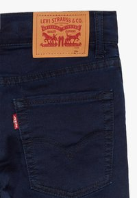 Levi's® - 510 KNIT JEAN - Skinny džíny - dark blue - 4