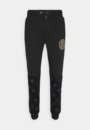SINTOS JOGGER - Pantalon de survêtement - black/gold