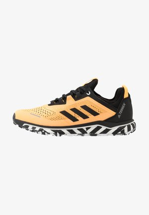 TERREX AGRAVIC FLOW RUNNING - Trail running shoes - solar gold/core black/footwear white