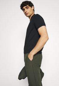 Marc O'Polo - SHORT SLEEVE BUTTON - Polo shirt - black - 4