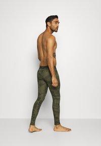 Nike Performance - Leggings - medium olive/white - 5