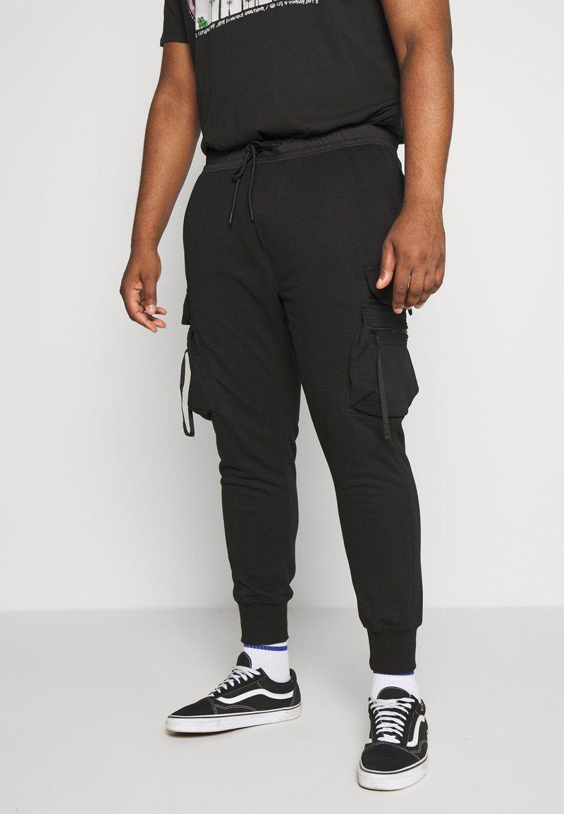 Urban Classics - TACTICAL PANTS - Tracksuit bottoms - black