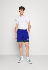 adidas Originals - TAPED UNISEX - Shorts - team royal blue - 1
