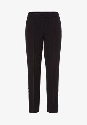 MIT SEITLICHEM SCHRIFTBAND - Trousers - black