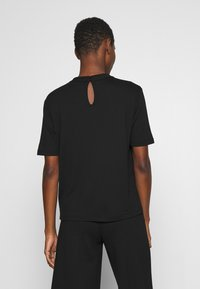 someday. - KUMI - Basic T-shirt - black - 2