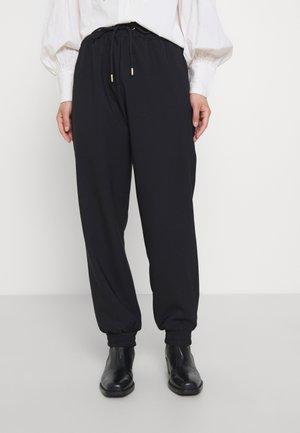ONLMILEY PANTS - Tracksuit bottoms - black