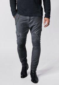 Tigha - Trousers - vintage black - 0