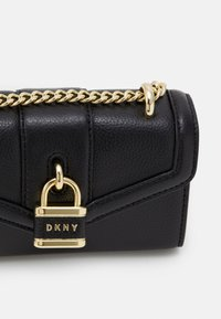 DKNY - ELLA MINI FLAP SHOULDER - Across body bag - black/gold-coloured - 3