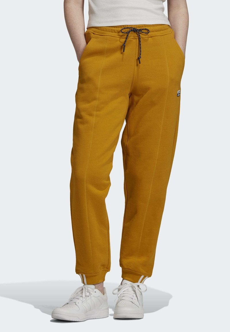 adidas Originals - Tracksuit bottoms - legacy gold