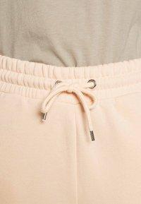 Monki - KARDI PANTS - Tracksuit bottoms - beige - 4