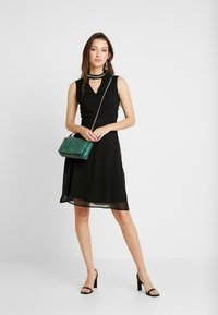 ONLY - ONLRAMON DRESS - Vestido de cóctel - black - 1