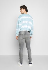 Tigha - MORTEN - Jeans slim fit - mid grey - 2
