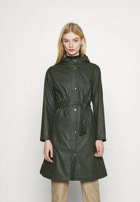 KnowledgeCotton Apparel - JASMINE LONG RAIN JACKET - Waterproof jacket - forrest night - 0