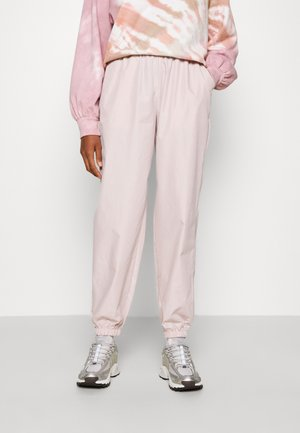 SPORTY - Tracksuit bottoms - pink