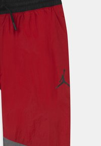 Jordan - JUMPMAN WAVE WIND - Tracksuit bottoms - gym red - 2