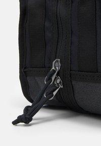 Nike Sportswear - UTILITY BAG UNISEX - Wash bag - black/black/white - 4