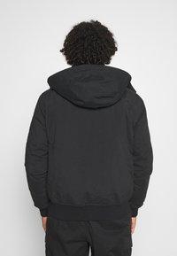 Calvin Klein Jeans - TRIMMED JACKET - Down jacket - black - 3