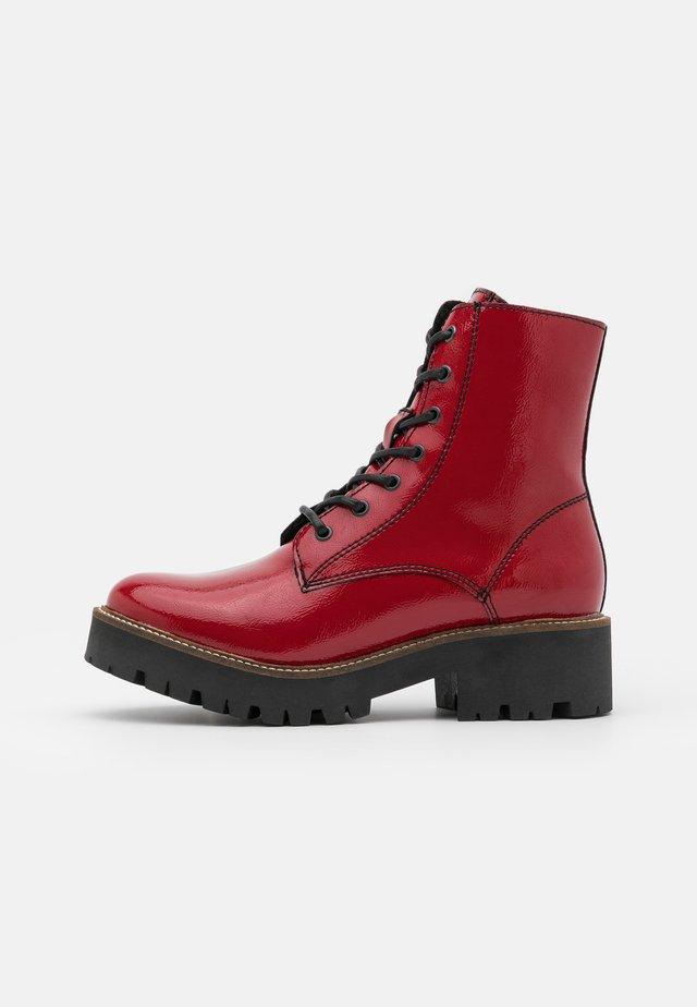 Platform ankle boots - red