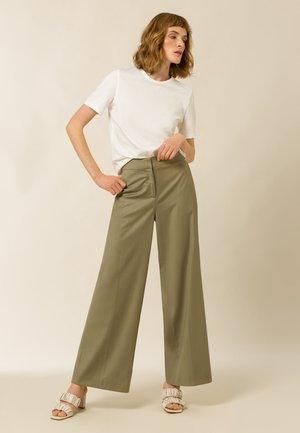 YUKKA - Trousers - sage green