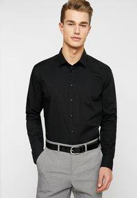 Seidensticker - SLIM FIT - Formal shirt - schwarz - 0