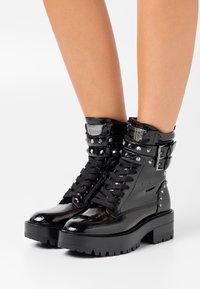 Guess - FLORICE - Cowboy/biker ankle boot - black - 0