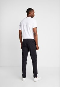 Tommy Hilfiger Tailored - PANTS - Pantalones chinos - black - 2