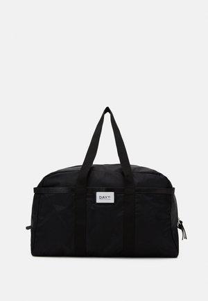 GWENETH NIGHTER - Weekend bag - black